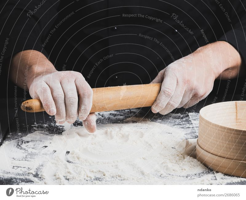 wooden rolling pin in men's hands Dough Baked goods Bread Table Kitchen Work and employment Cook Human being Hand Wood Black Rolling pin chef Flour Baking