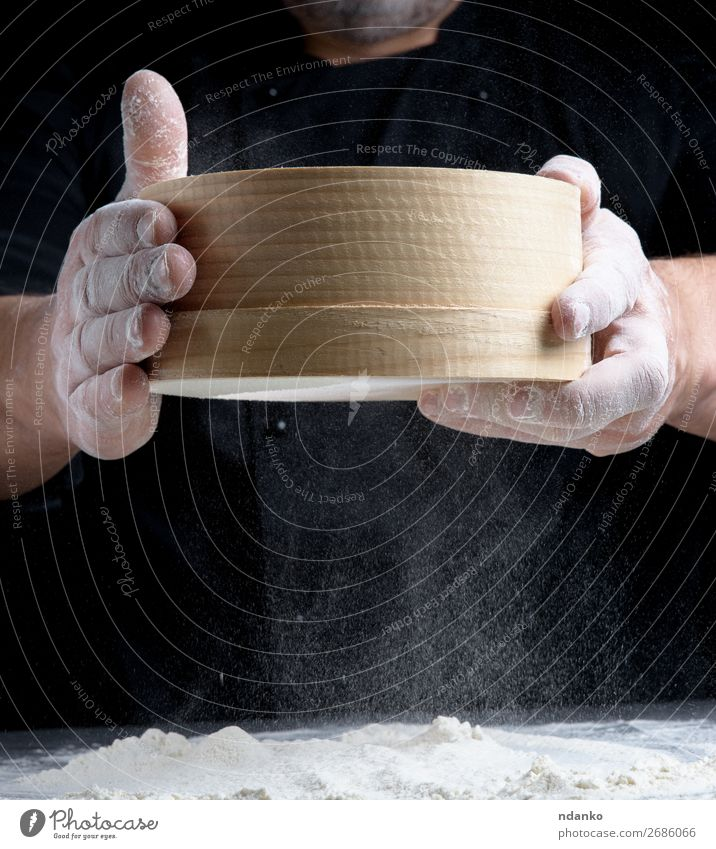 round wooden sieve in male hands Human being Man White Hand Dark Black Adults Wood Movement Nutrition Fresh Table Kitchen Baked goods Cooking Bread