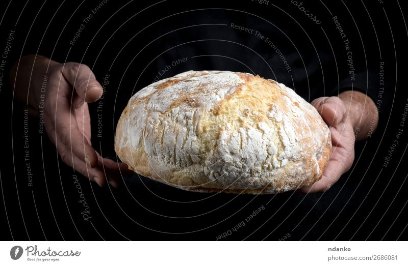 chef hands hold a whole loaf of baked round bread Human being White Hand Dark Black Adults Brown Nutrition Fresh Kitchen Tradition Cooking Bread Make Meal