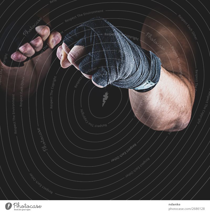 athlete stands in a fighting stance Lifestyle Fitness Sports Sportsperson Man Adults Hand Fingers 1 Human being 30 - 45 years Stand Aggression Dark Muscular