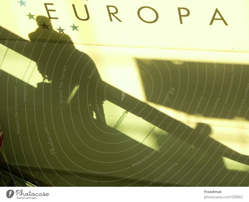 Europe Escalator Wall (building) Businesspeople Hannover Direction Diagonal Meaning Human being Silhouette Typography Politics and state Window Shadow