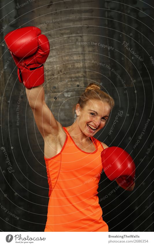 Woman in boxing gloves with hand up win gesture Joy Sports Martial arts Sportsperson Success Young woman Youth (Young adults) Adults Arm 1 Human being Smiling