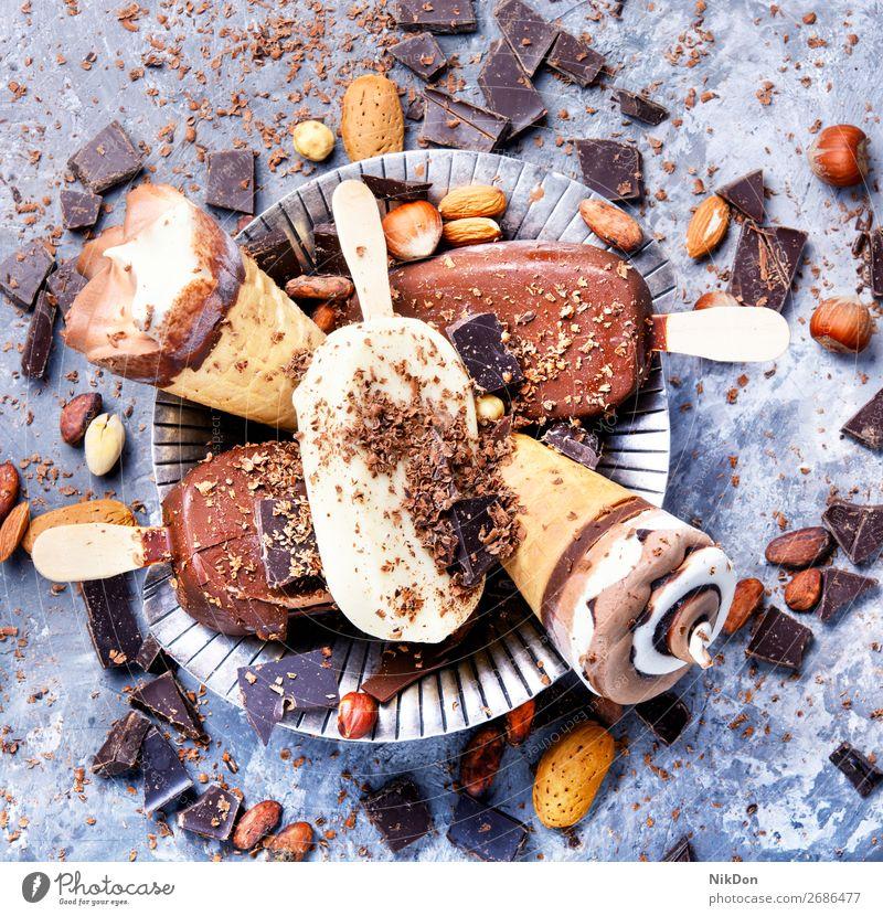 chocolate ice cream with nuts vanilla icecream dessert sweet frozen cold delicious summer flavor dairy ice-cream milk cone cocoa creamy calorie black sherbet
