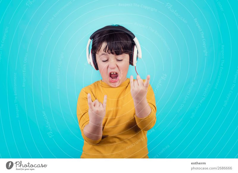 Boy with headphones showing rock sigh Child Human being Blue Joy Lifestyle Emotions Boy (child) Leisure and hobbies Masculine Modern Music Smiling Infancy