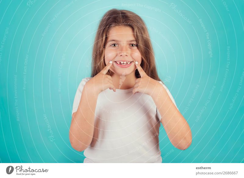 little girl making smile Lifestyle Joy Wellness Success Human being Feminine Infancy Teeth 1 8 - 13 years Child Fitness Smiling Laughter Growth Cool (slang)