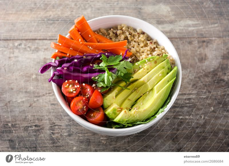 Vegan Buddha bowl with fresh raw vegetables and quinoa on wood buddha bowl Bowl Vegetable Avocado Onion Tomato Carrot Cabbage Food Healthy Eating