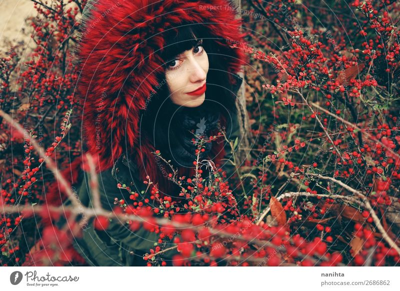 beautiful young brunette woman in red Woman Human being Nature Youth (Young adults) Colour Beautiful Red Forest Winter Black 18 - 30 years Face Lifestyle Adults