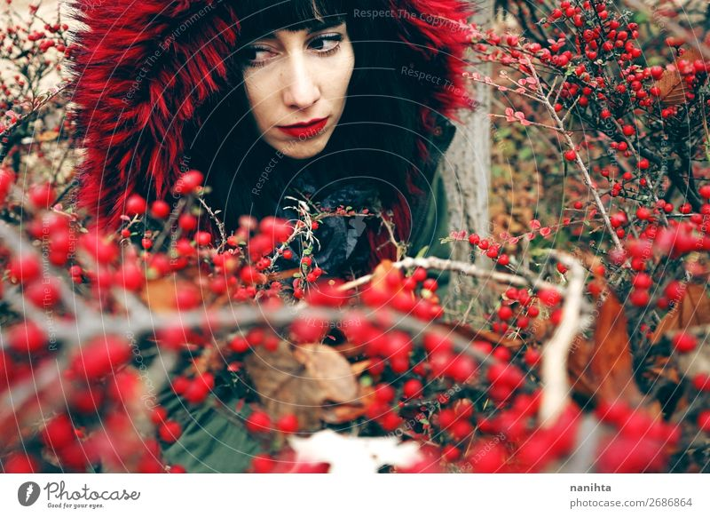 beautiful young brunette woman in red with hood Woman Human being Nature Youth (Young adults) Young woman Colour Beautiful Red Forest Winter Black 18 - 30 years