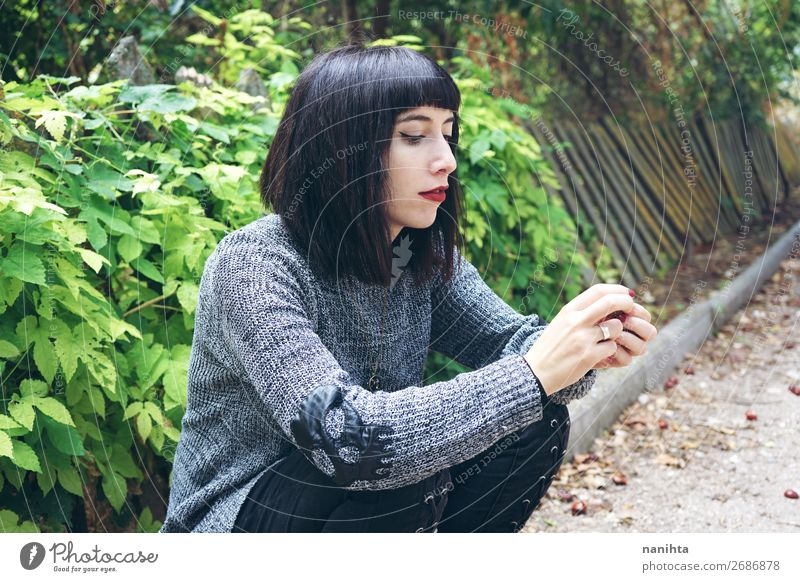brunette woman sitting on ground in a park Lifestyle Style Happy Beautiful Relaxation Calm Human being Feminine Young woman Youth (Young adults) Woman Adults 1