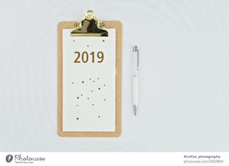 New year 2019 calendar with notebook and pen on white Design Table New Year's Eve Success Paper Pen Wood White Beginning Inspiration Future goal solution