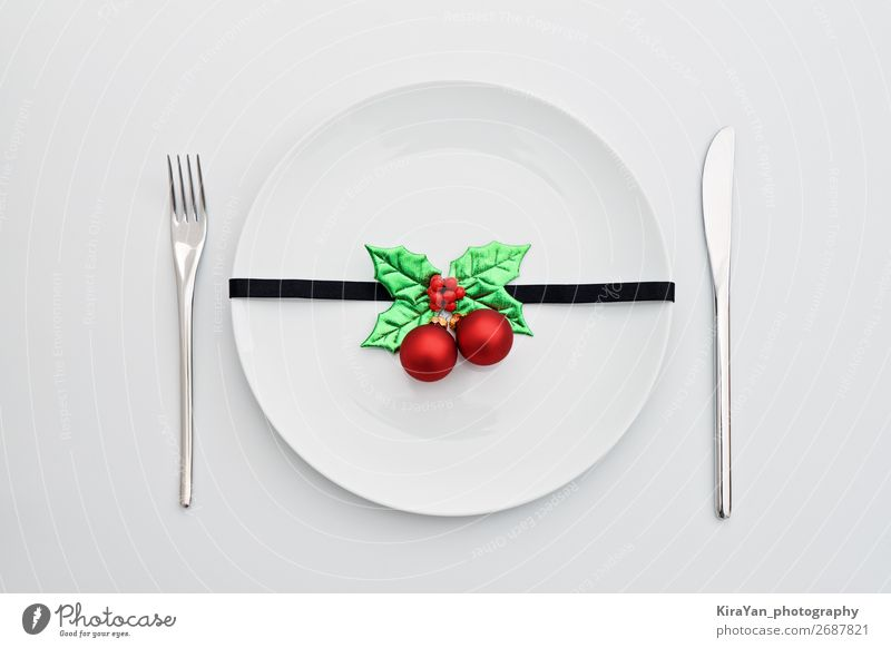 Christmas decoration with holly leaves and red balls Dinner Plate Cutlery Fork Decoration Restaurant Feasts & Celebrations Christmas & Advent New Year's Eve