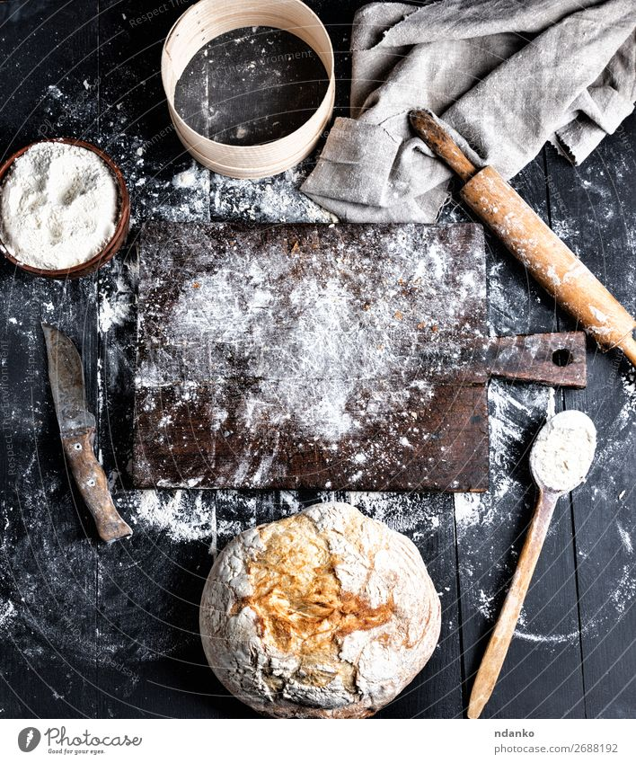 baked bread, white wheat flour, wooden rolling pin Dough Baked goods Bread Bowl Knives Spoon Table Kitchen Sieve Wood Make Dark Fresh Above Brown Black White