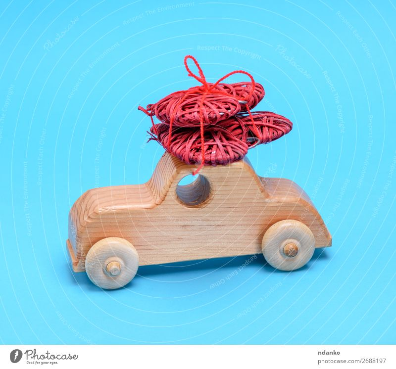 small wooden children's car carries a wicker red heart Feasts & Celebrations Valentine's Day Car Toys Wood Heart Old Movement Love Carrying Small Natural Retro