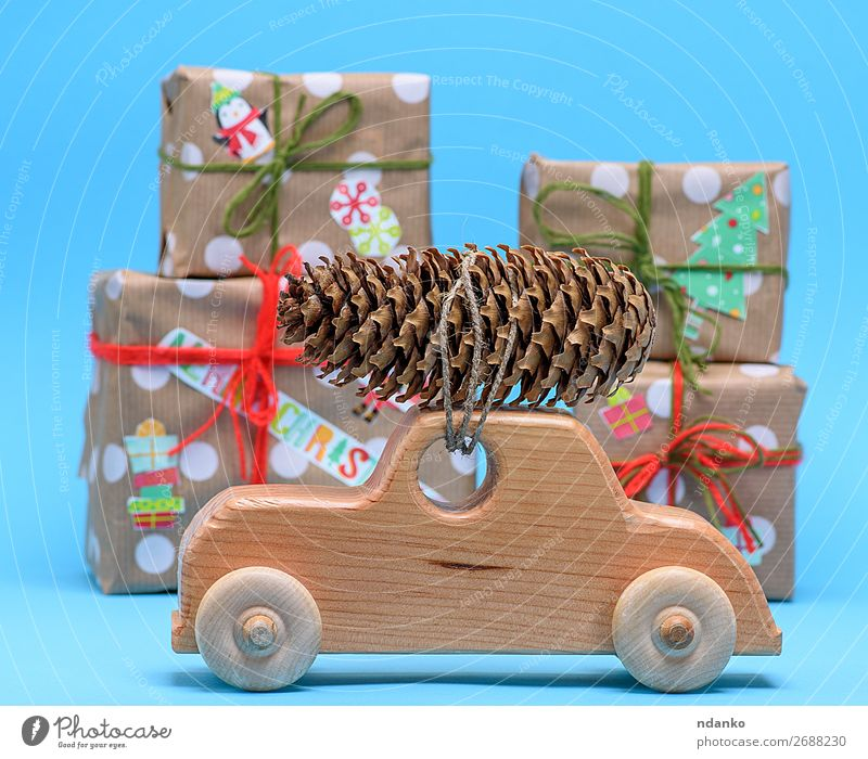 wooden machine carries a rope tied cone Nature Christmas & Advent Blue Tree Winter Wood Yellow Movement Feasts & Celebrations Brown Decoration Car Transport