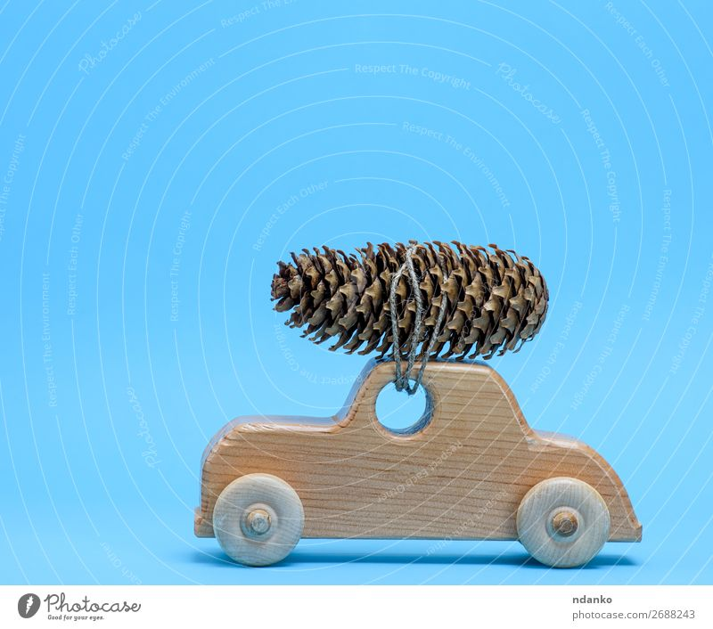wooden toy car carries on top a pine cone Decoration Feasts & Celebrations Christmas & Advent New Year's Eve Transport Car Toys Wood Movement Retro Blue Brown