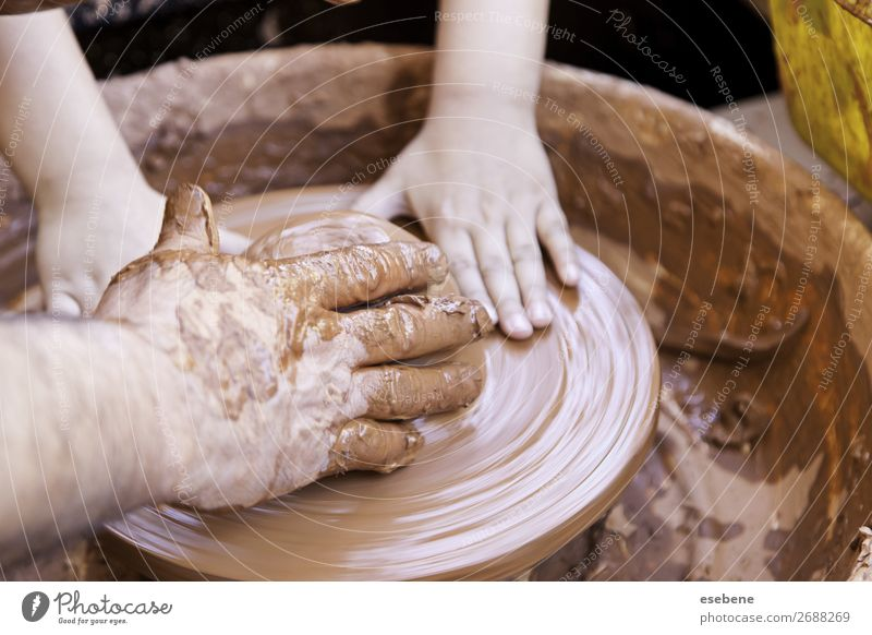 Person working with clay Bowl Pot Handicraft Work and employment Craft (trade) Human being Woman Adults Man Fingers Art Touch Make Dirty Wet Brown Creativity