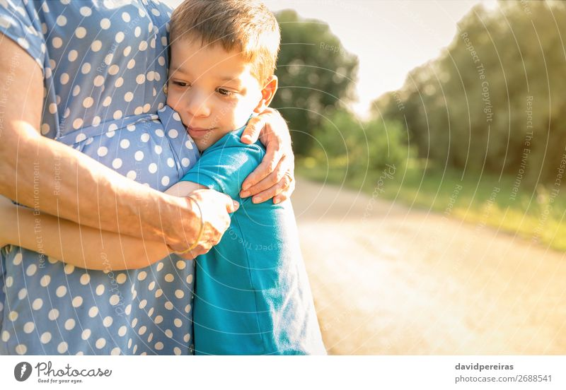 Grandson hugging to his grandmother outdoors Woman Child Human being Nature Man Old Summer Relaxation Lifestyle Adults Love Family & Relations Laughter Happy