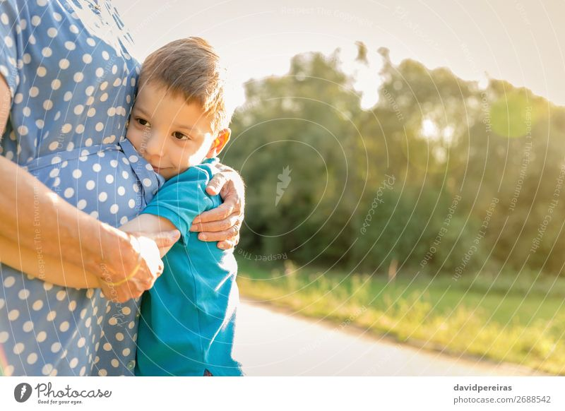Happy grandson hugging to his grandmother outdoors Woman Child Human being Nature Man Old Summer Relaxation Lifestyle Adults Love Family & Relations Laughter