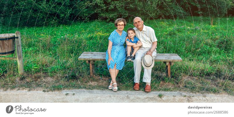 Grandparents and grandson posing for a photo Lifestyle Happy Leisure and hobbies Child Technology Human being Boy (child) Woman Adults Man Grandfather