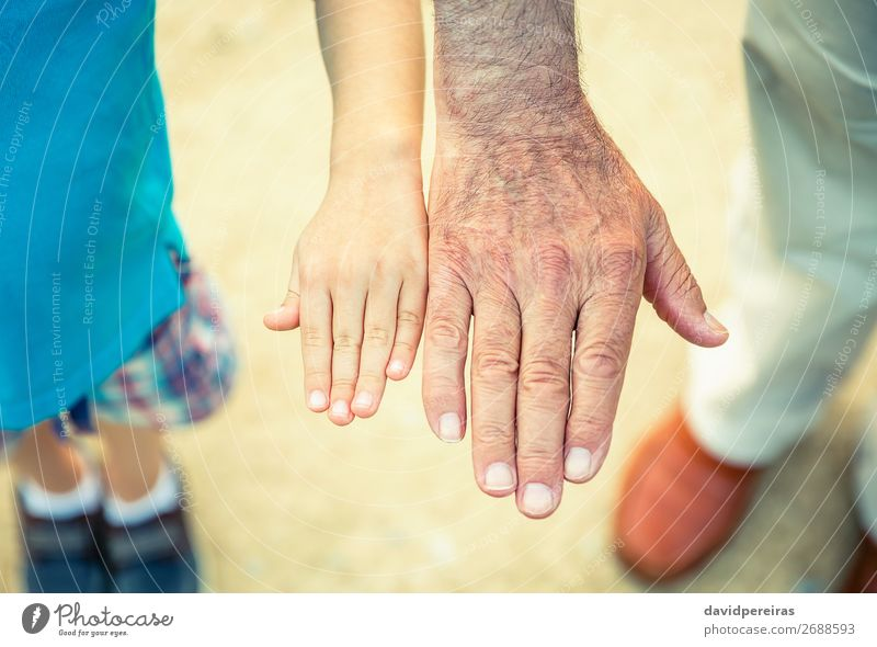 Child and senior man comparing his hands size Skin Life Retirement Human being Baby Boy (child) Man Adults Parents Father Grandfather Family & Relations Hand