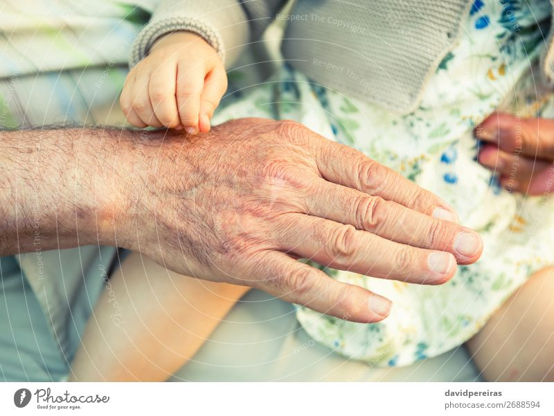 Baby girl touching hand of senior man Skin Life Child Retirement Human being Woman Adults Man Parents Father Grandfather Family & Relations Hand Fingers Old