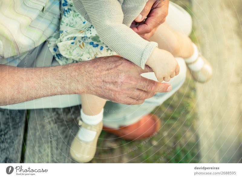Baby girl holding finger of senior man hand Skin Life Child Retirement Human being Woman Adults Man Parents Father Grandfather Family & Relations Hand Fingers