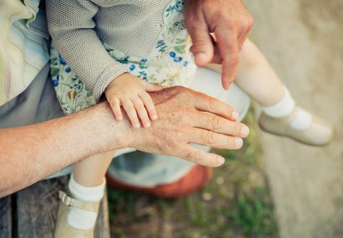 Baby girl touching hand of senior man Skin Life Child Retirement Human being Woman Adults Man Grandfather Family & Relations Hand Nature Old Touch Love