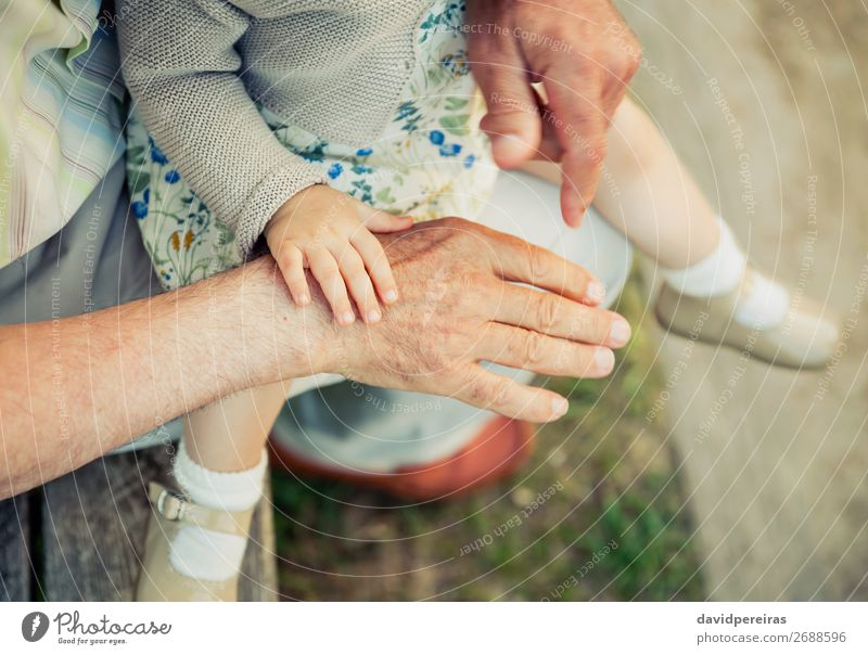 Baby girl touching hand of senior man Woman Child Human being Nature Man Old Hand Adults Life Love Family & Relations Small Together Skin Authentic