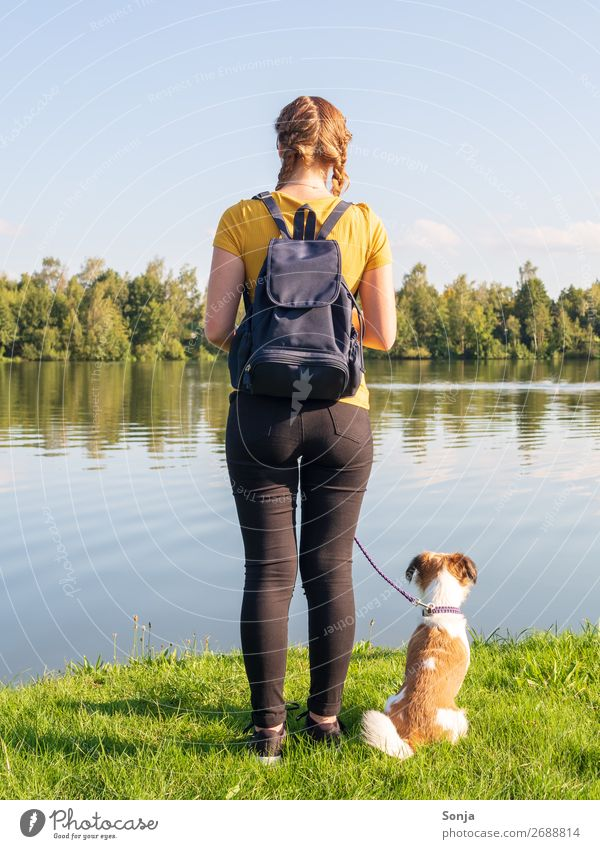 Young woman with small dog at the lake Lifestyle Summer Hiking Human being Feminine Youth (Young adults) 1 18 - 30 years Adults T-shirt Jeans Braids Dog Animal