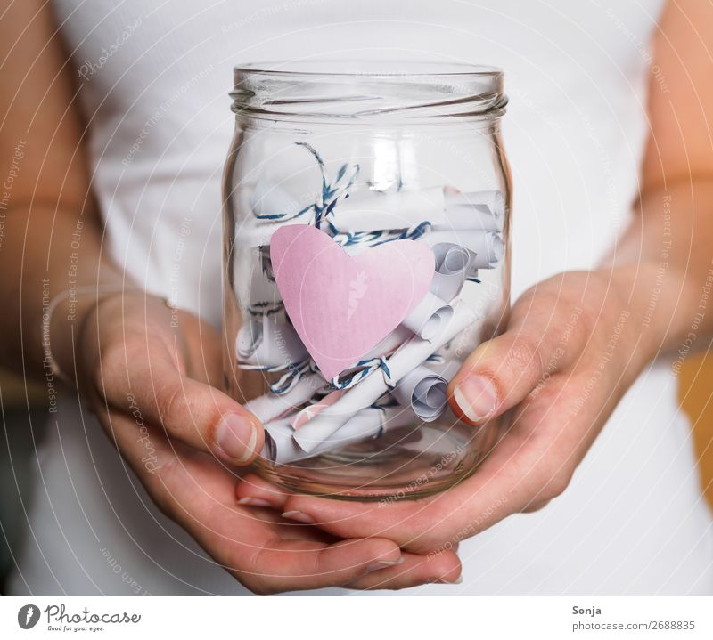 preserving jar with pink heart and notes Lifestyle Human being Feminine Young woman Youth (Young adults) Hand 1 18 - 30 years Adults Piece of paper