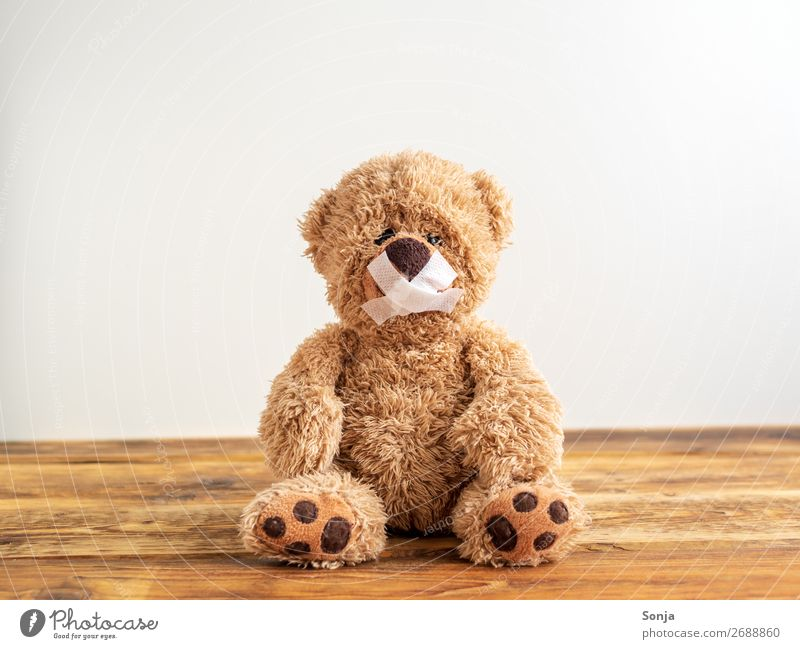 Teddy bear with mouth taped shut Adhesive plaster Sign Sit Cry Emotions Truth Honest Integrity Fairness Sadness Concern Pain Disappointment Loneliness Guilty