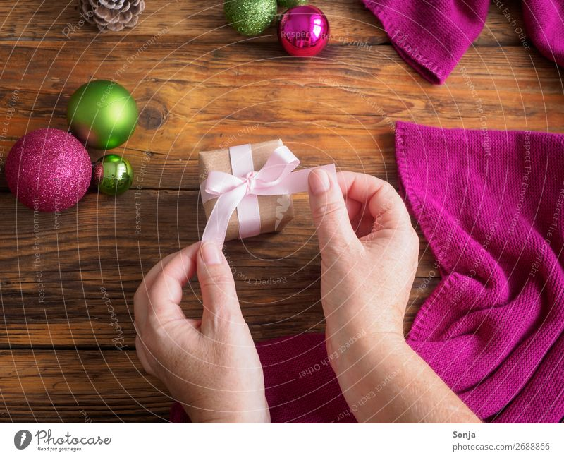 Woman with gift package in her hands Christmas & Advent Feminine Hand 1 Human being 45 - 60 years Adults Bow Gift Make Hip & trendy Anticipation Patient