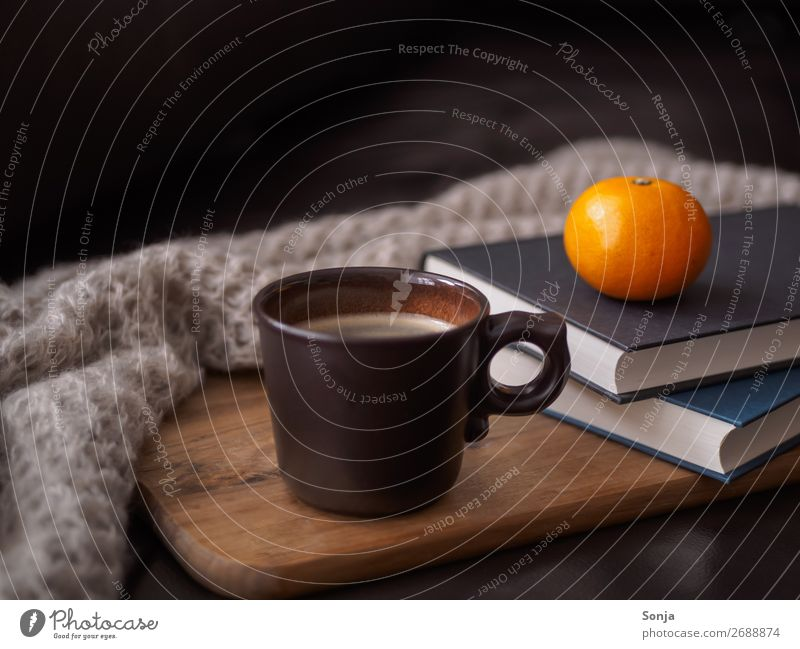 A cup of coffee on a leather couch Food Fruit Nutrition To have a coffee Beverage Hot drink Coffee Cup Lifestyle Leisure and hobbies Reading Book Old Relaxation