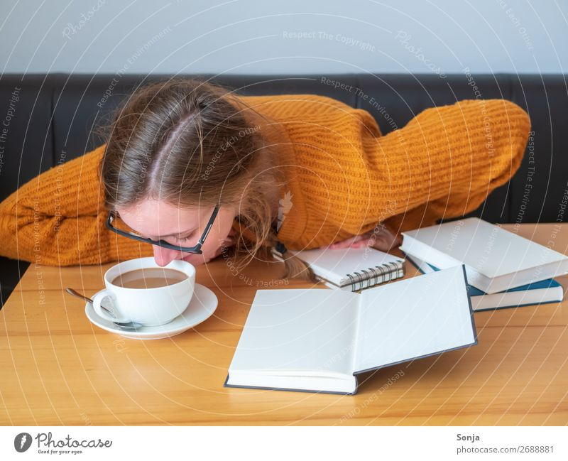 Young tired woman with a cup of coffee Hot drink Coffee Lifestyle Study University & College student Feminine Young woman Youth (Young adults) 1 Human being