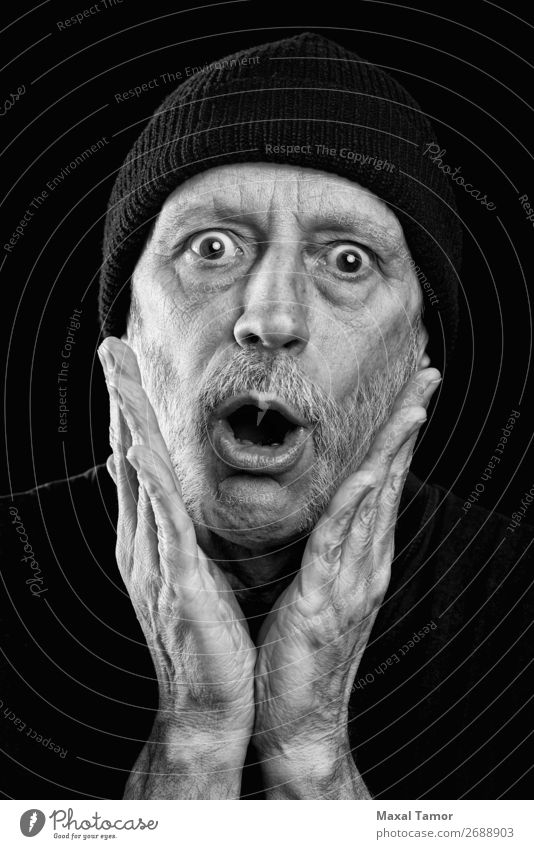 Surprised strong man with a beard and a woolen cap Face To talk Loudspeaker Human being Man Adults Mouth Hand Beard Scream Sadness Crazy Anger Black White