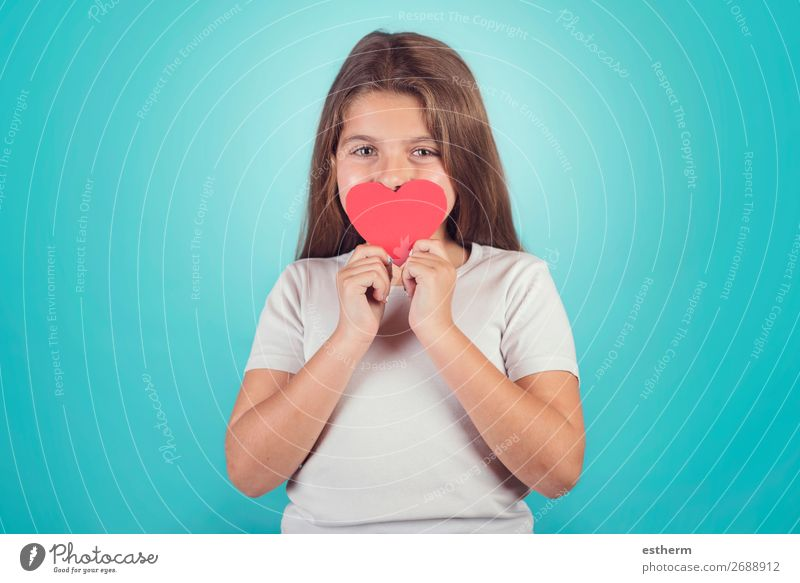 smiling girl with a heart covering her lips on blue background Lifestyle Joy Feasts & Celebrations Valentine's Day Mother's Day Human being Feminine Girl