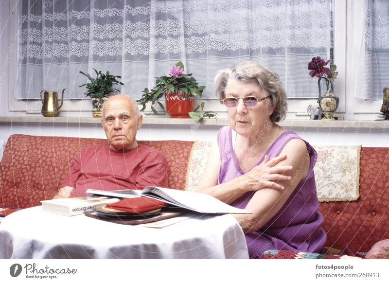 Human being Old Senior citizen Together Living or residing Idyll Action 60 years and older Table Joie de vivre (Vitality) Reading Grandmother Sofa Living room