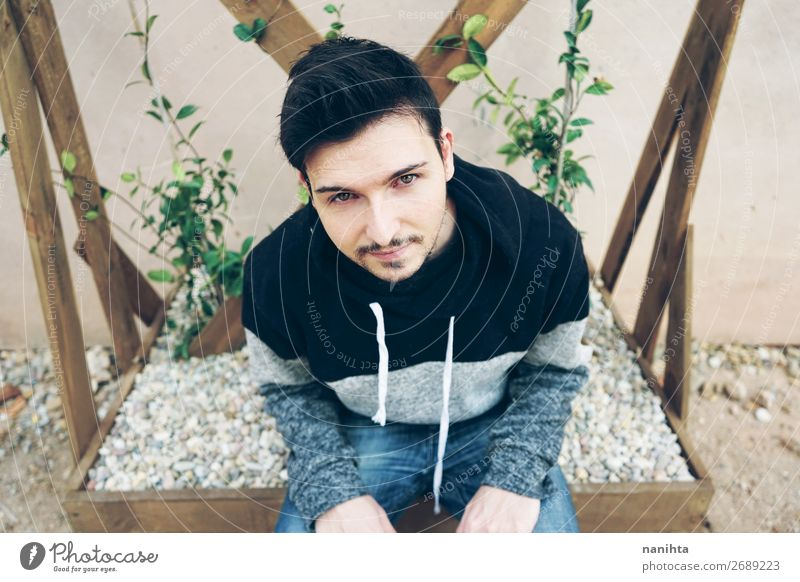 A young attractive man with deep look Lifestyle Style Face Human being Masculine Man Adults 1 30 - 45 years Fashion Beard Sit Cool (slang) Fresh Eroticism Brown