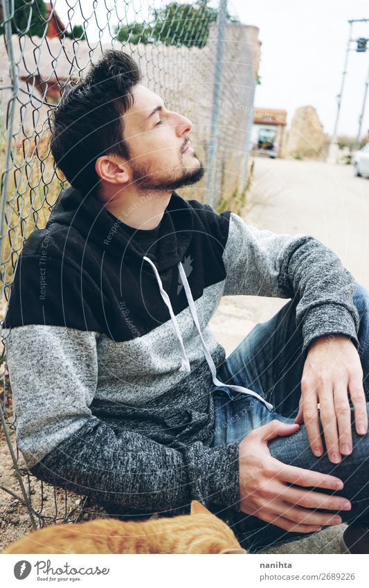 A young attractive man in calm Lifestyle Style Relaxation Human being Masculine Man Adults 30 - 45 years Beard To enjoy Sit Cool (slang) Fresh Brown Moody Joy