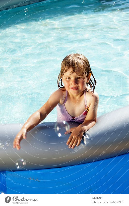 Human being Child Blue Water Summer Girl Joy Relaxation Warmth Playing Emotions Happy Swimming & Bathing Infancy Wet Happiness