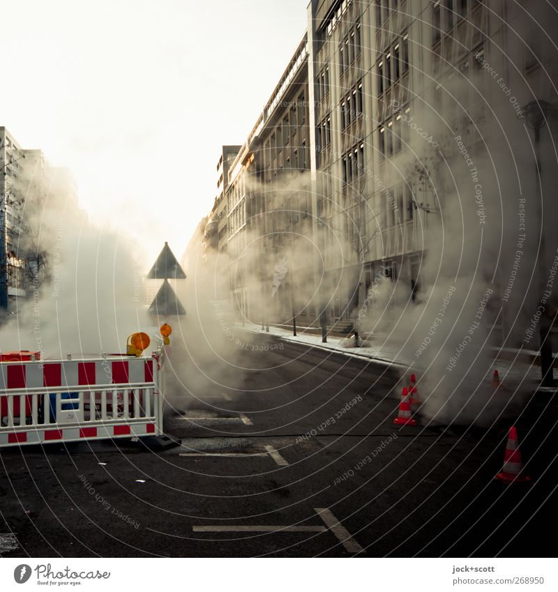 More smoke Around nothing Winter Downtown Berlin Facade Traffic infrastructure Street Road sign Construction site Signs and labeling Warning sign Smoking chill