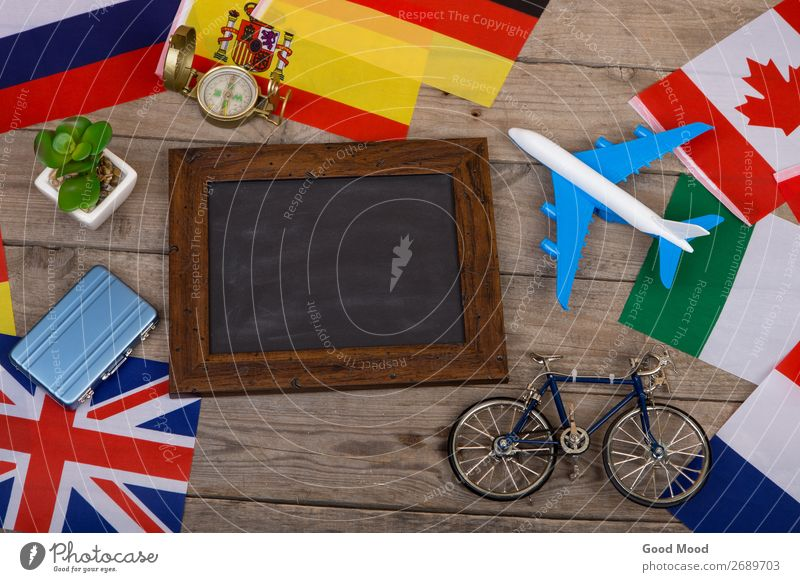 blank blackboard, flags of countries, airplane, bicycle Vacation & Travel Relaxation Wood Business Tourism Copy Space Freedom Earth Flying Trip