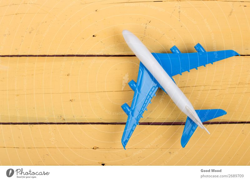 Toy plane on yellow wooden background Joy Leisure and hobbies Playing Vacation & Travel Trip Desk Table Child Transport Airplane Biplane Aircraft Toys Wood