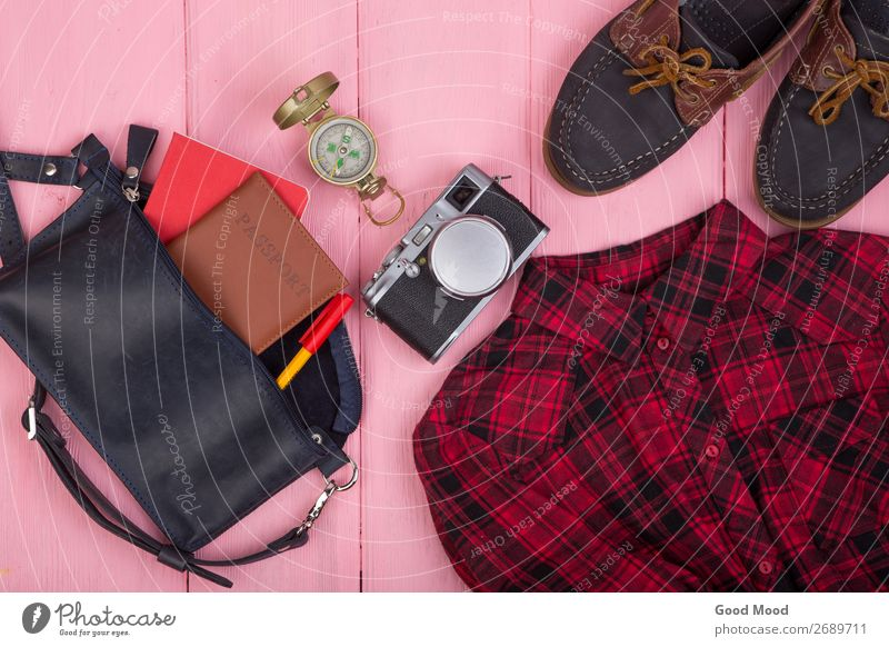 bag, passport, camera, compass, shoes, shirt, note pad Vacation & Travel Blue Red Lifestyle Wood Business Tourism Fashion Pink Trip Retro Table Footwear