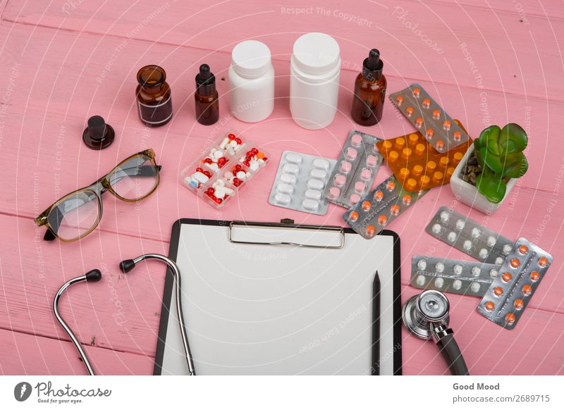 blank clipboard, medicine bottles, stethoscope, pills Wood Health care Copy Space Pink Heart Paper Eyeglasses Illness Medication Science & Research Doctor