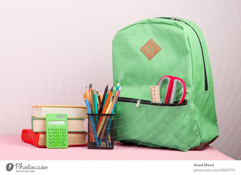 backpack and school supplies: notepad, books, scissors Child Vacation & Travel Green Wood Copy Space School Pink Trip Table Book Academic studies Tool Pencil