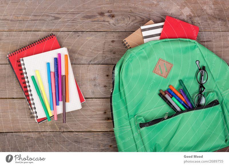 Backpack and school supplies: notepad, felt-tip pens Child Green Wood Copy Space School Brown Table Academic studies Eyeglasses Tool Set Grade (school level)
