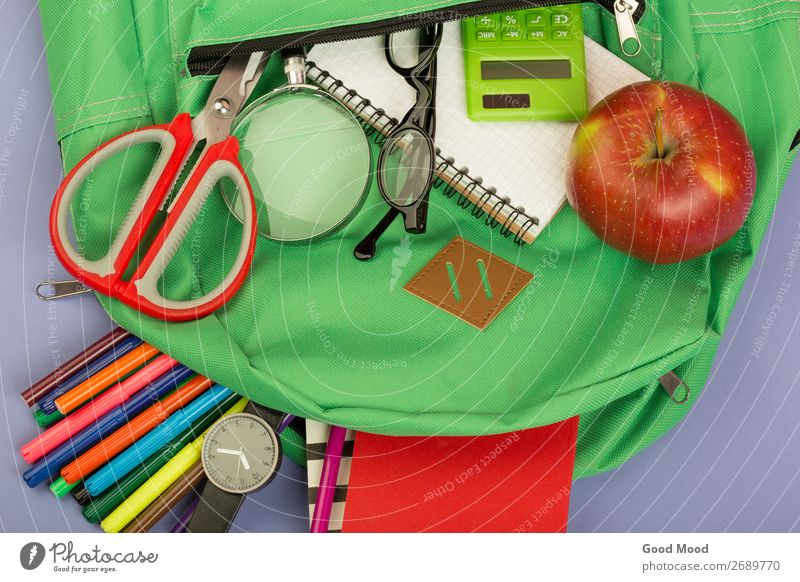 Backpack and school supplies: magnifying glass, notepad Child Blue Green School Gray Table Paper Observe Academic studies Eyeglasses Tool Set Scissors