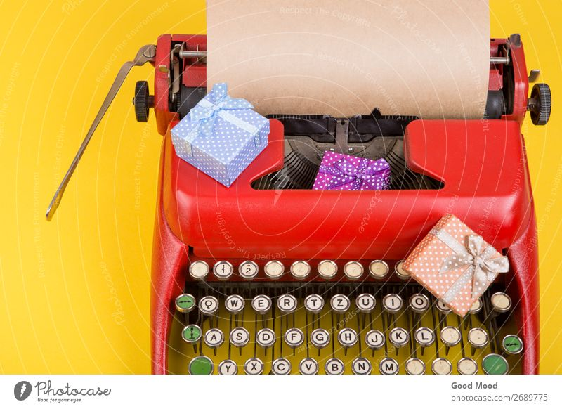Holidays concept - red typewriter withpaper, gift boxes Old Christmas & Advent Red Adults Yellow Feasts & Celebrations Business Copy Space Retro Technology