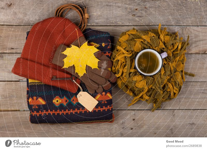 cup of tea, maple leaves, key with blank label, warm clothes Tea Lifestyle Shopping Relaxation Leisure and hobbies Vacation & Travel Trip Winter Table